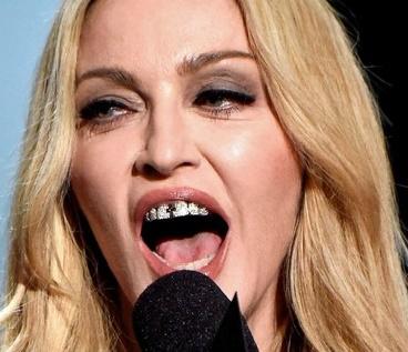 Сенсация: Мадонна подсела на фотошоп!